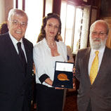 Photo: UNPA: Clarissa Fürnsinn (centre) receives award from Maurizio Stella, organizer of the event (left) and Bruno Crevato Selvaggi, moderator of the ceremony