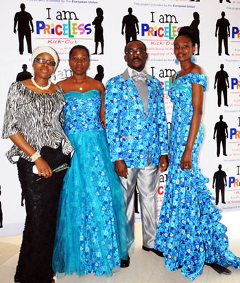 Photo: UNODC Nigeria staff model outfits made from a customized Blue Heart fabric, Ankara, whose design features the blue heart. On the left is the designer of the outfits, Binta Shuaibu