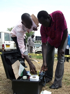 Course participants accesses equipment and materials from the supplied crime scene investigation kits during a practical training exercise. CSI training Juba, South Sudan